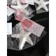 Segnaposto stella marina in gesso ceramico in sacchetto